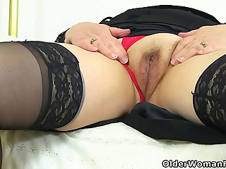 English granny Susan pleases their way hungry pussy with a dildo