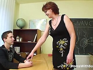 A mature redhead teacher with big tits despairing young cocks
